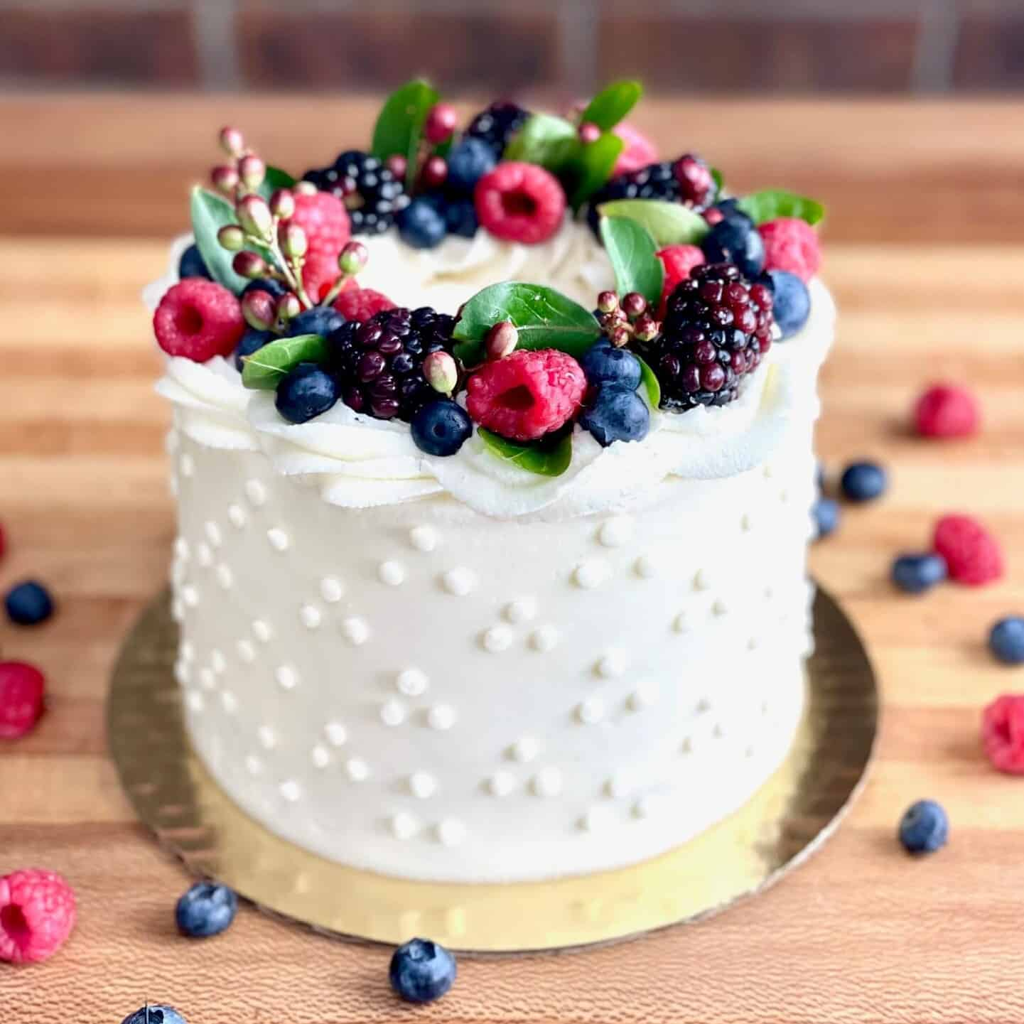 Vanilla Almond Cake with Triple Berry Compote Filling