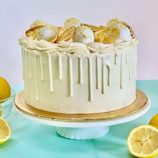 Decorated Lemon cake with lemon cake truffles and sugared lemon slices