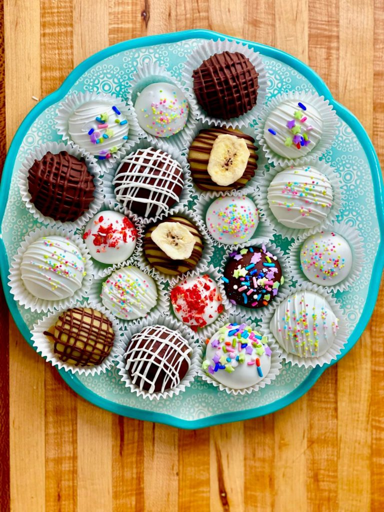 bakery-style cake truffles on a plate